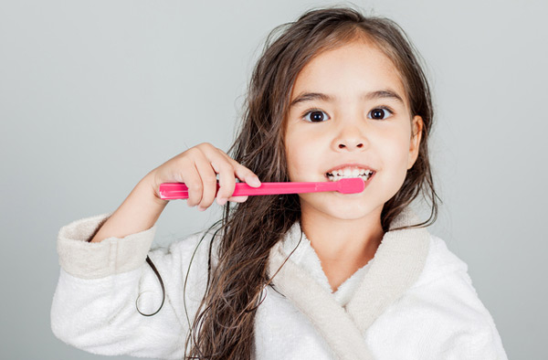 Young girl brushing her teeth.